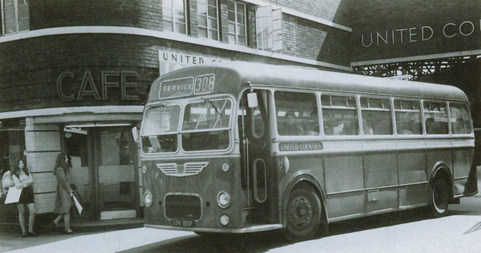 A black and white photo of a single deck bus leaving Derngate Bus station in 1971.